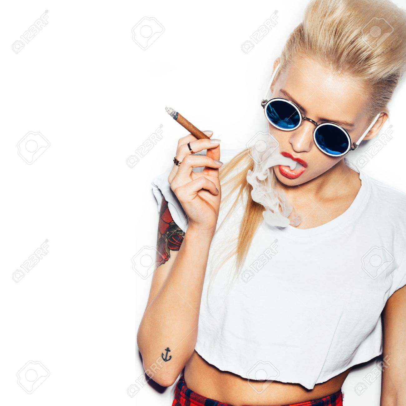Sexy Woman In Sunglasses And White T Shirt Blowing Smoke From