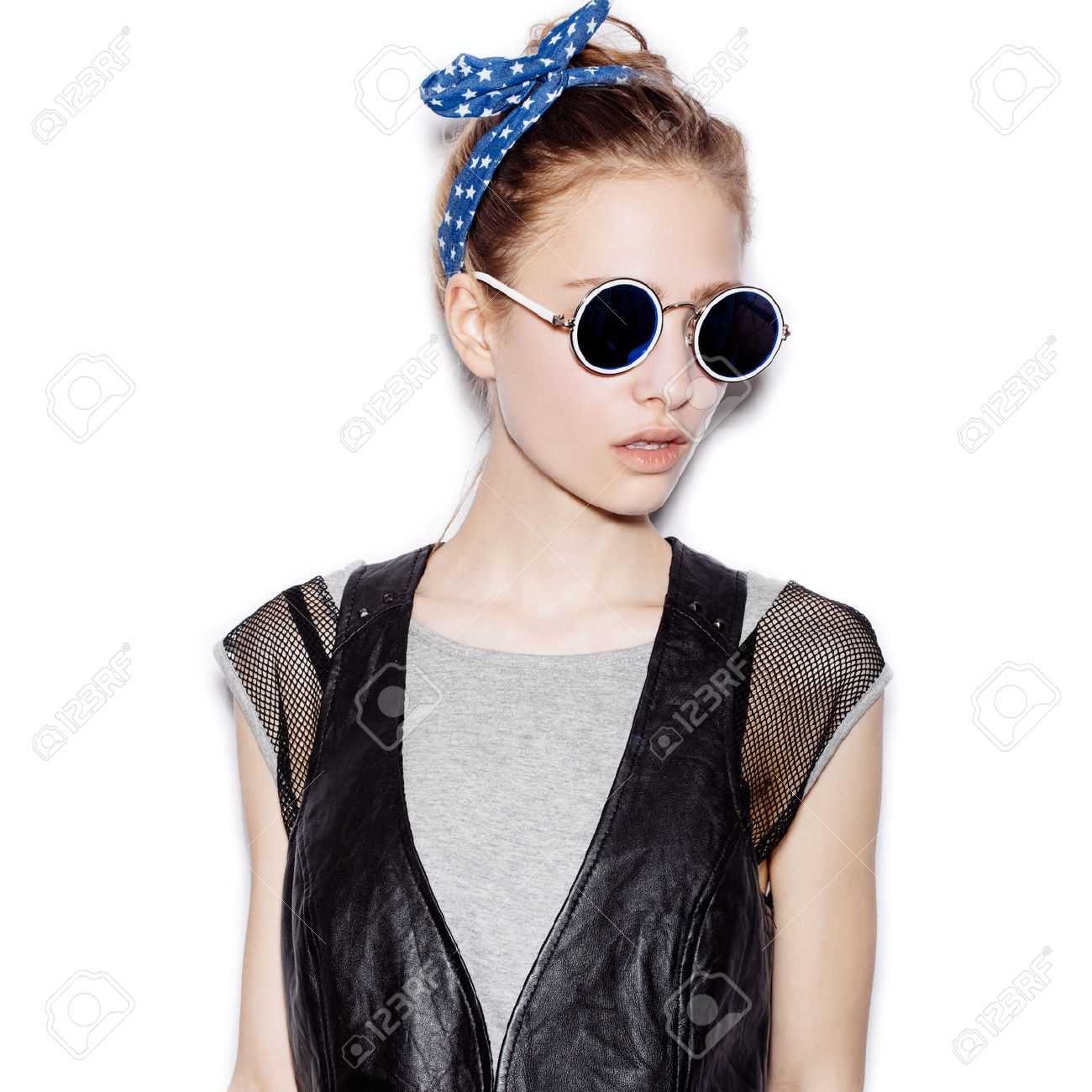 4b39fcb677 Fashion portrait of beautiful girl wearing sunglasses. Close-up of cute  woman on white