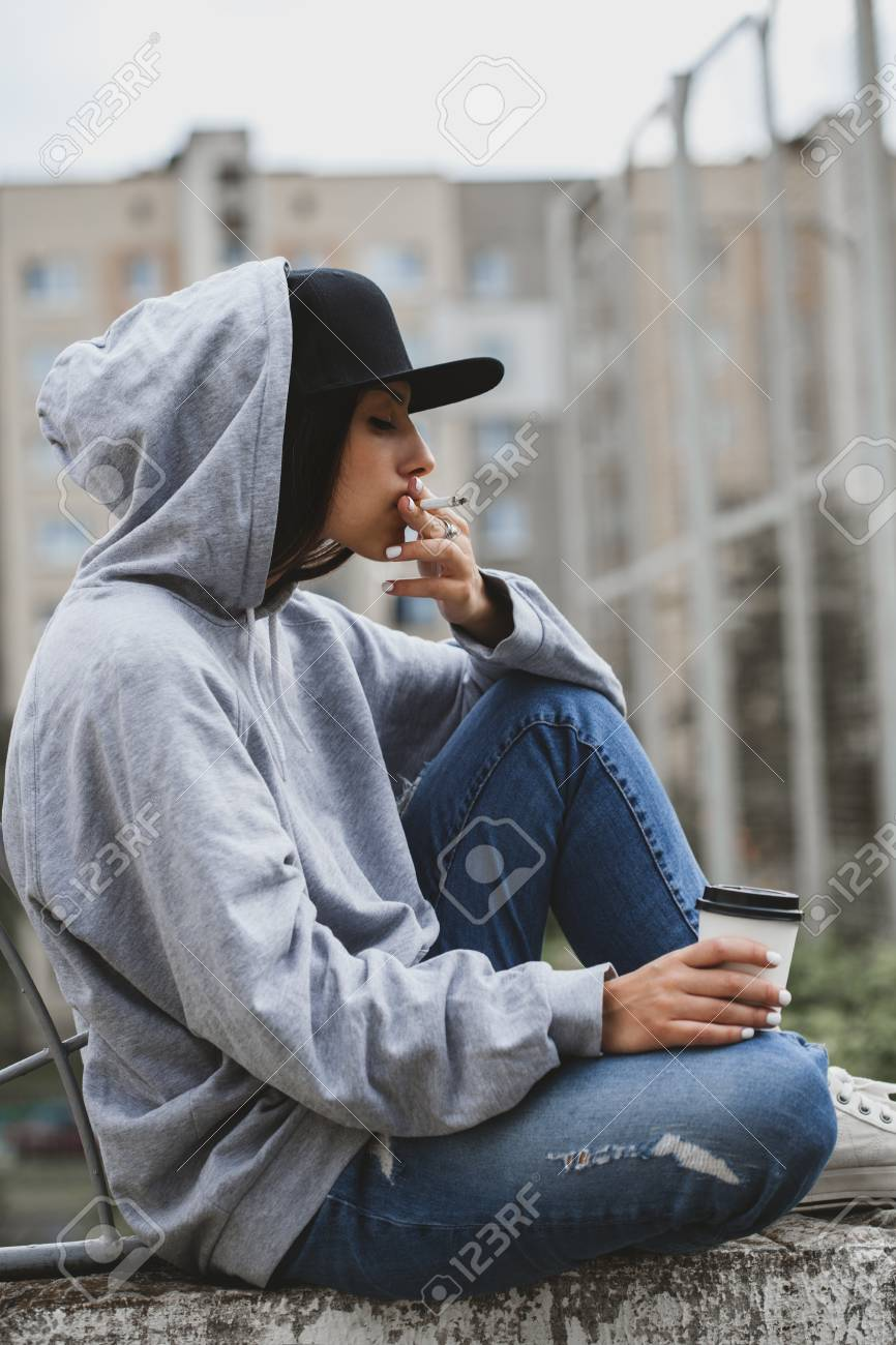 Swag Cool Girl Smoking Cigarrete And Drinking Coffee Sitting Stock Photo Picture And Royalty Free Image Image 90585064