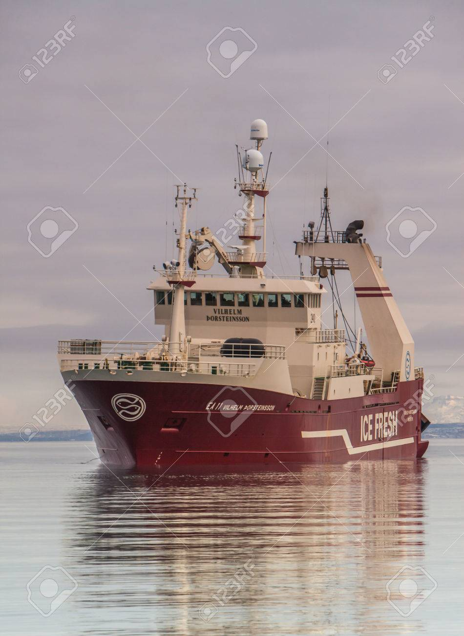 Helguvik, Iceland - March 12, 2013   Offshore commercial pelagic fishing vessel approaching port in Helguvik, Iceland,  fully loaded with Capelin   Stock Photo - 25131436