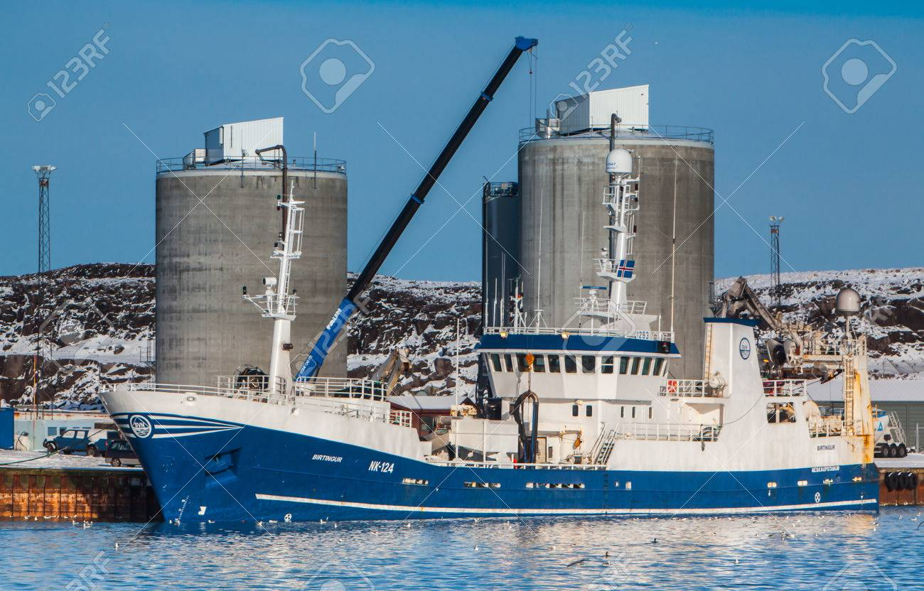 Helguvik, Iceland - February 17, 2012    Pelagic fishing vessel 1923 Birtingur NK-124 unloading Capelin to fishmeal plant    Stock Photo - 25182605