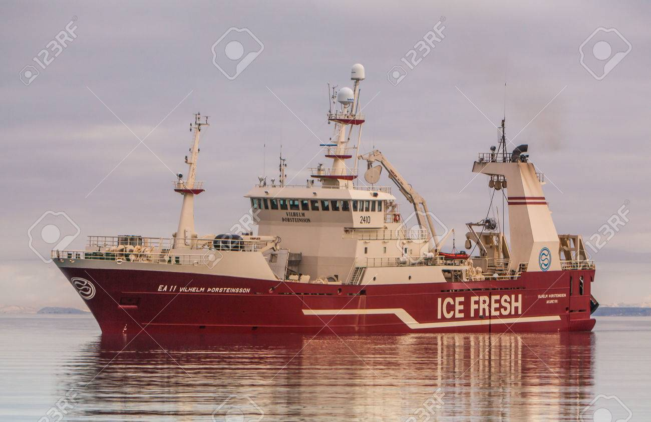 Helguvik, Iceland - March 12, 2013   Offshore commercial pelagic fishing vessel approaching port in Helguvik, Iceland,  fully loaded with Capelin   Stock Photo - 25220577