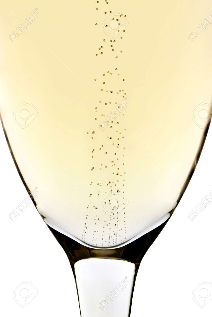 Rising bubbles in a champagne glass with white background Stock Photo - 7340013