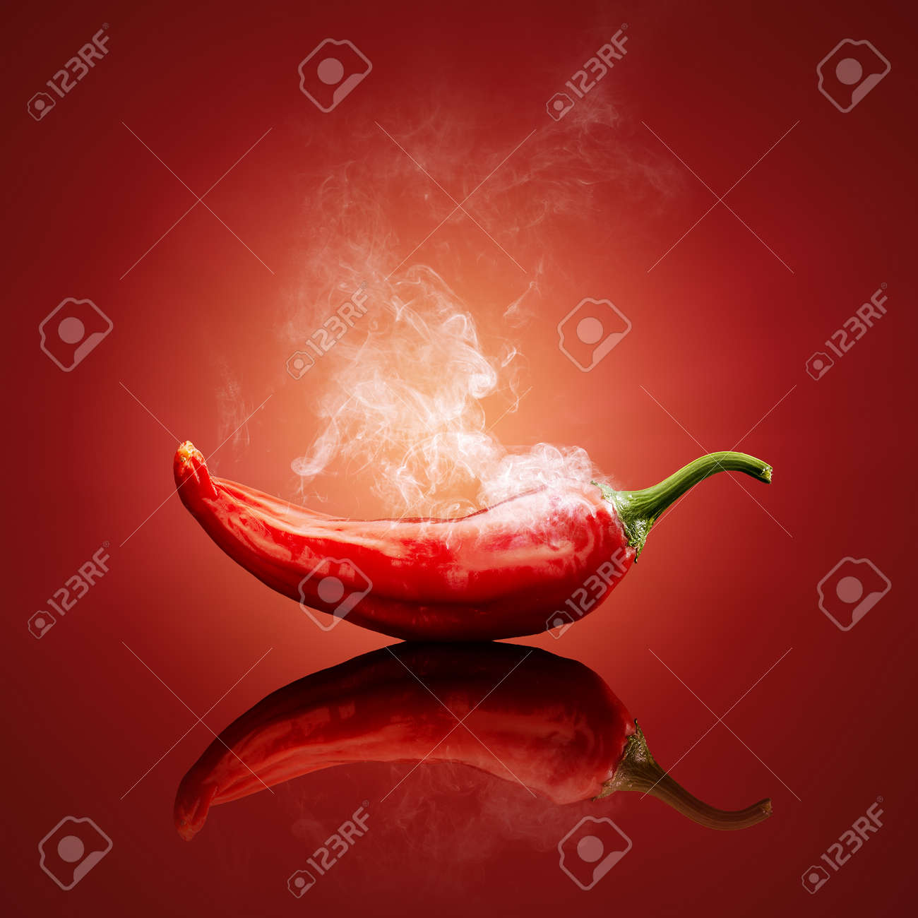 Hot chili red smoking or steaming with reflection - 39988067