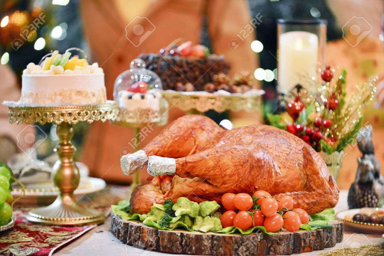 Roasted Turkey. Christmas dinner table served with turkey decorated with candles. Roasted & Roasted Turkey. Christmas Dinner Table Served With Turkey ...