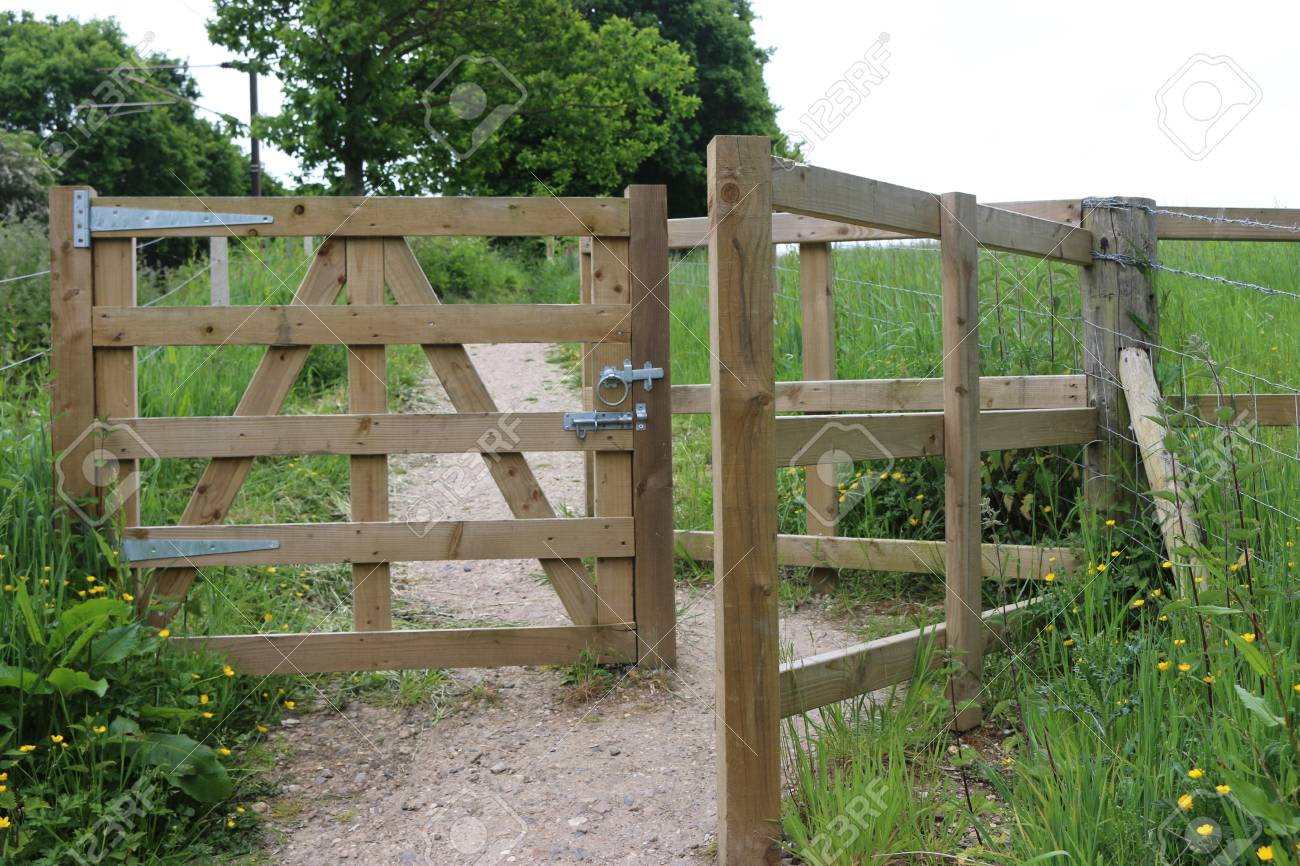 Picture of: Gate In A New Wooden Post And Rail Fence With Pedestrian Access Stock Photo Picture And Royalty Free Image Image 107385200
