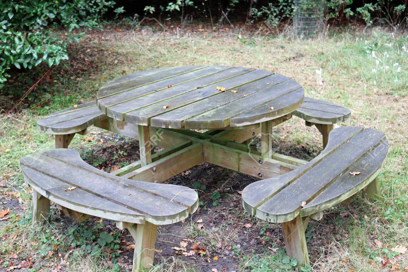 Round Wooden Picnic Table With Rounded Seats On Grass With Soil Stock Photo Picture And Royalty Free Image Image 142153146
