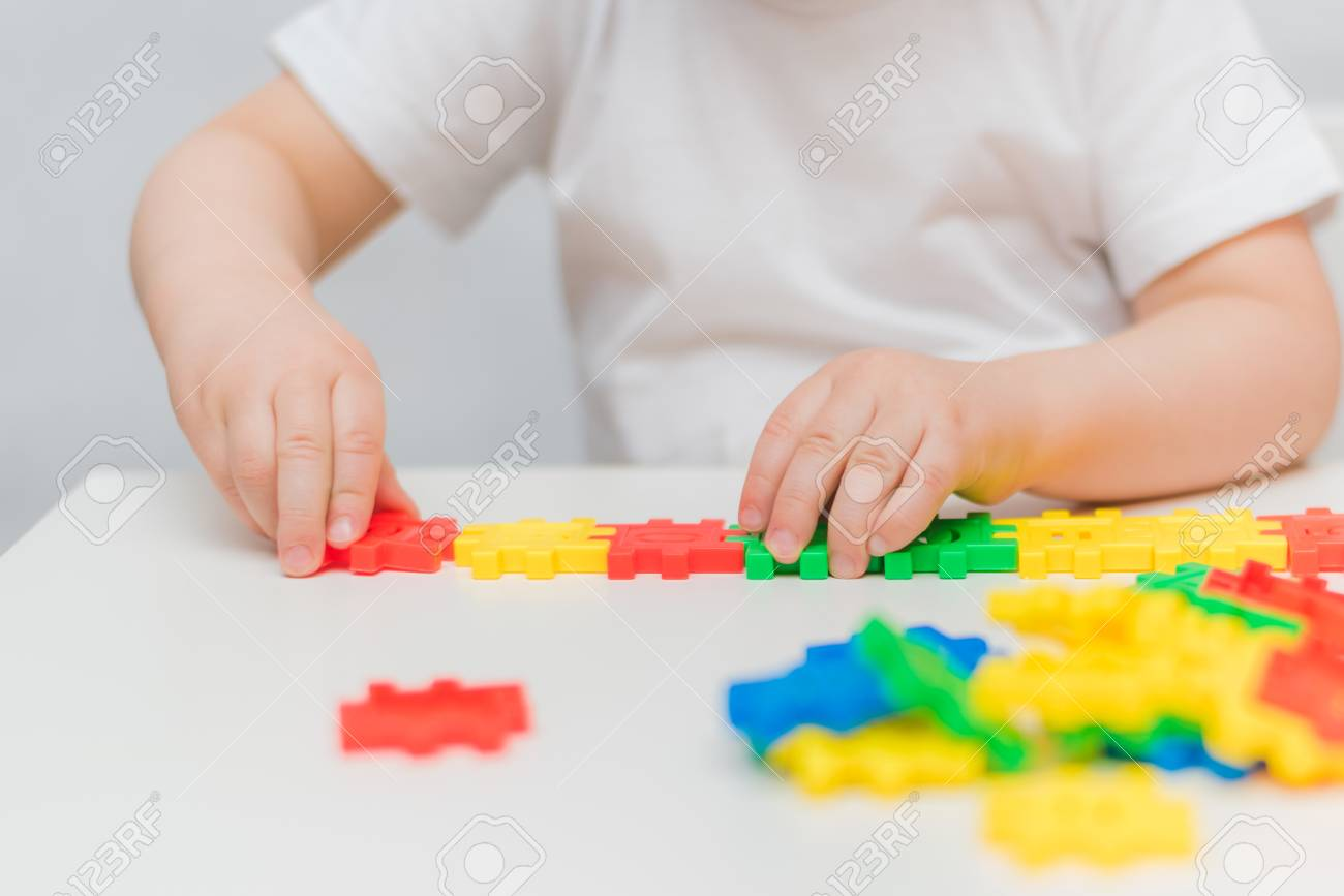 The Kid Plays With The Designer At Home Stock Photo, Picture And ...