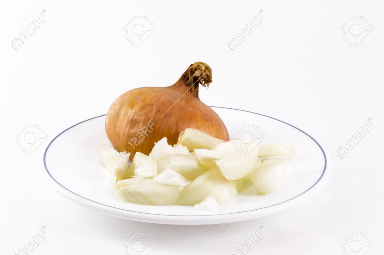 A single isolated plate of chopped onions ready for cooking - 37320556