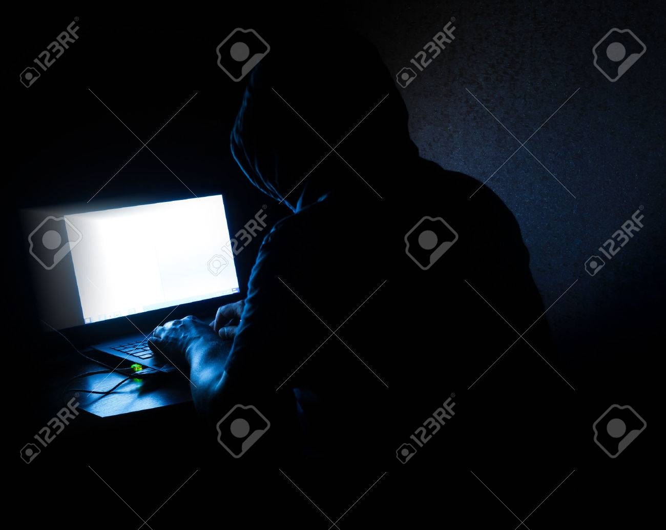 Mysterious computer hacker stealing data from a laptop - 40298724