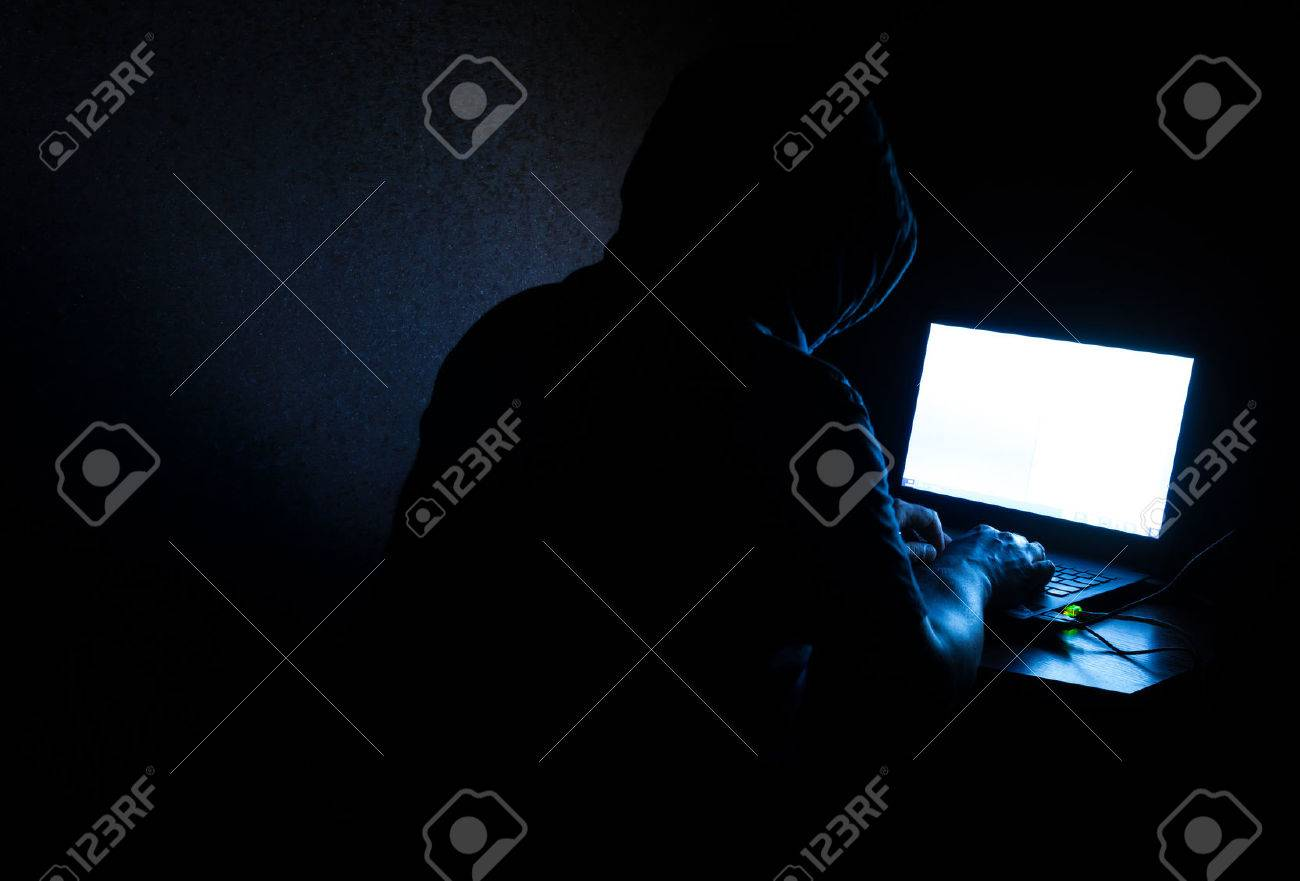 Single solitary computer hacker works in the dark committing crime - 40298733