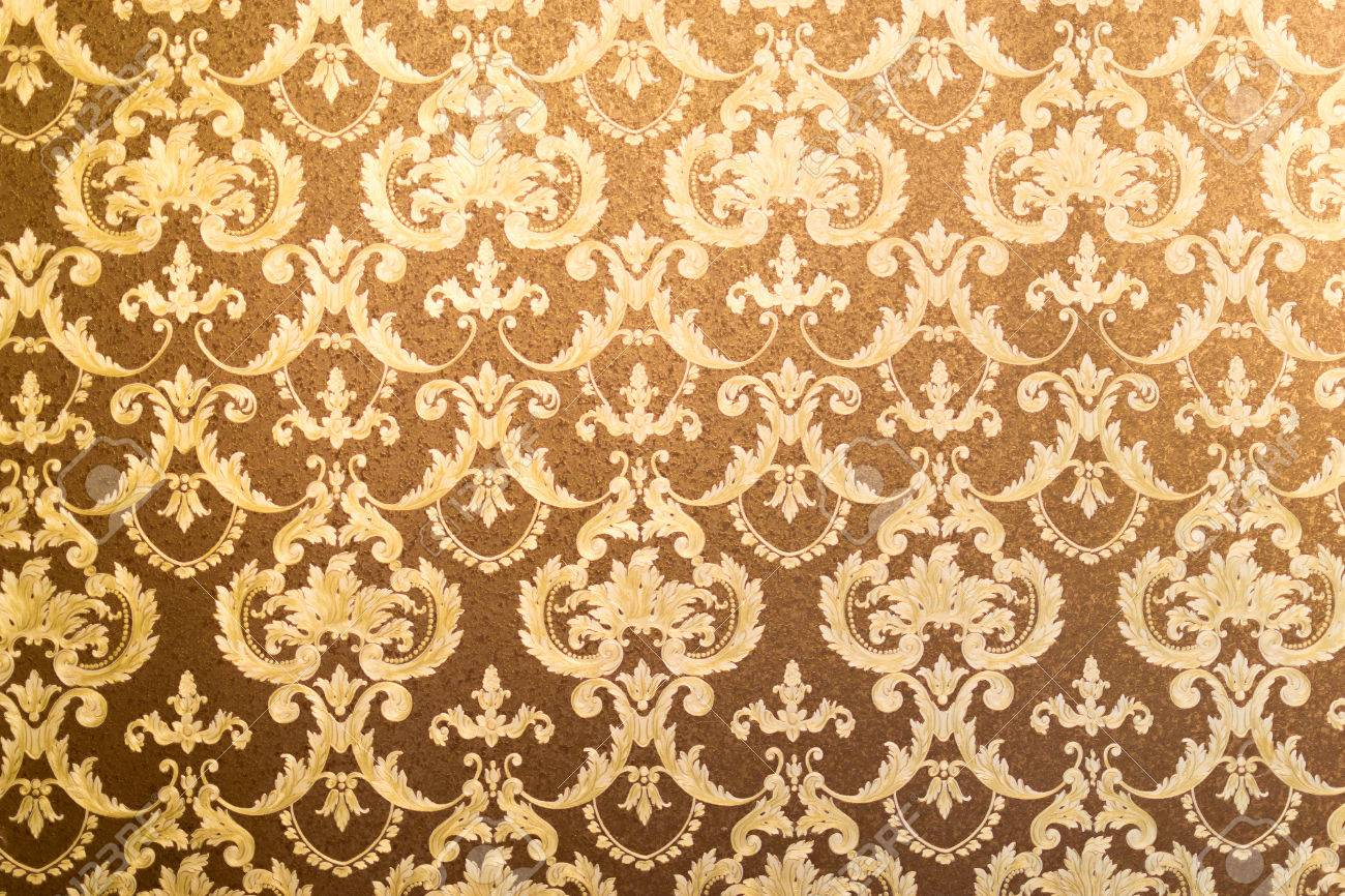 French Style Floral Wallpaper In Gilded Gold And Brown Stock Photo