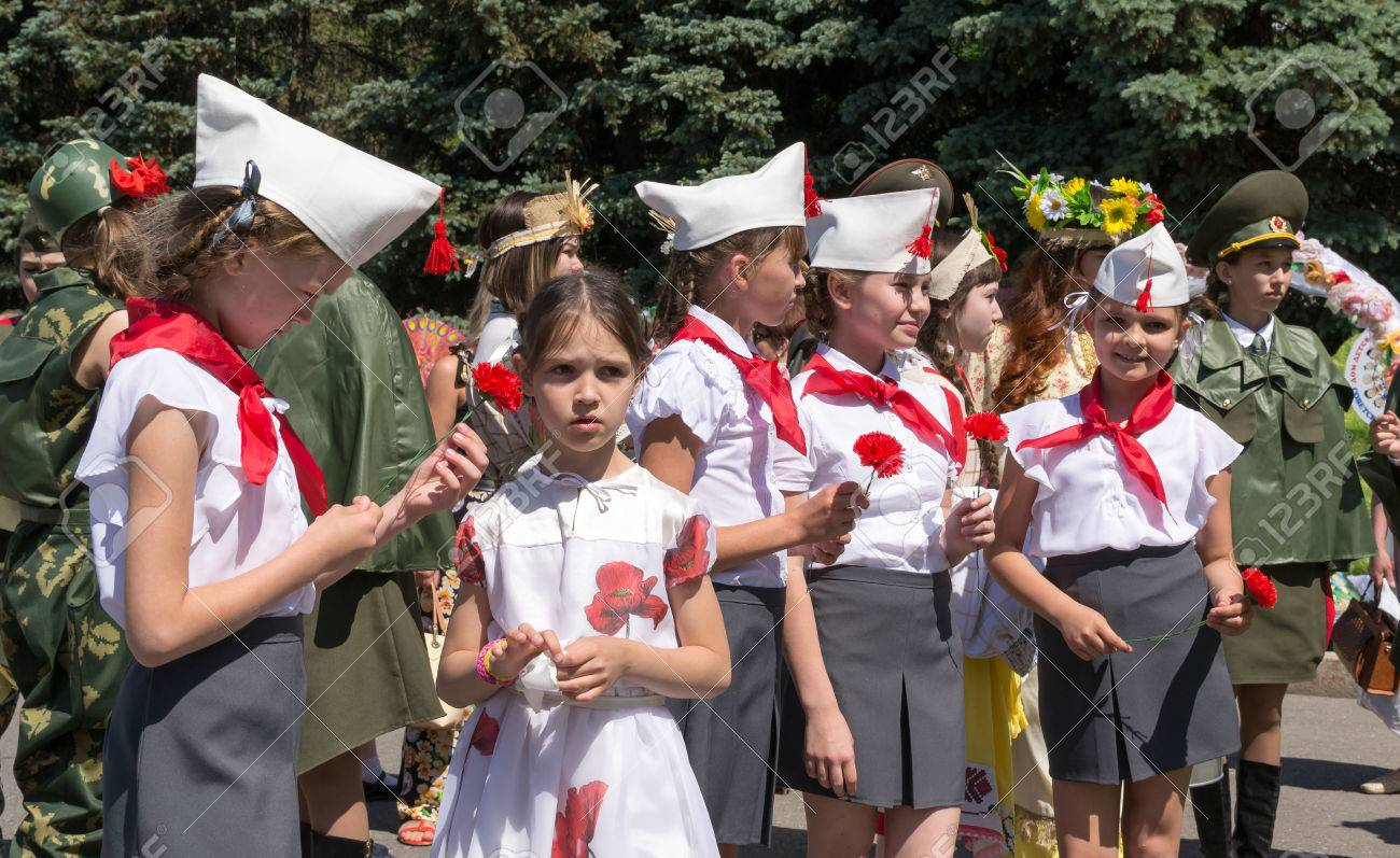 cf41e0d6f93 Line of young girls in traditional Red Army Uniforms and Communist Pioneer  uniforms as part of