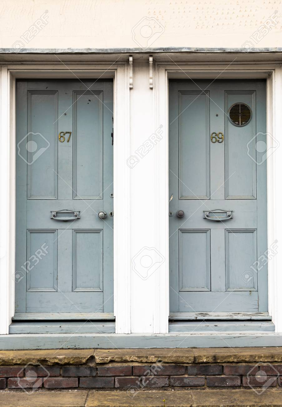 Pair Of Grey Painted Wooden Residential Front Doors Set In A.. Stock ...