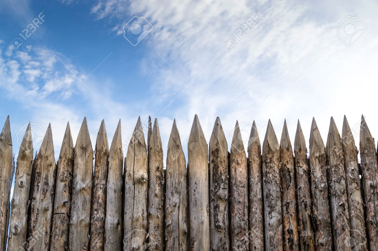 Wooden palisades form a defence barricade - 45967959