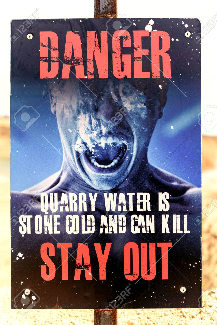 Cold water kills warning sign at a local quarry showing a man