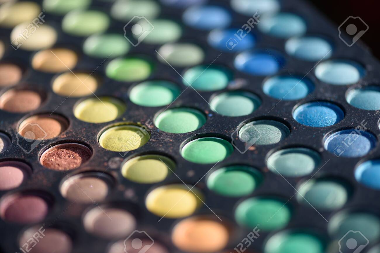 Closeup macro of paints used for makeup and face painting with different colours - 155300734