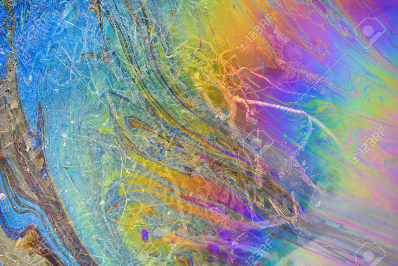 Toxic colours of oil and water in a chemical spill creating a psychedelic blur of rainbow colours. Copyspace area for environmental and pollution based themes and designs. - 155300752