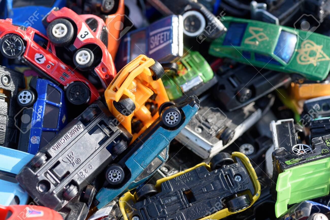 CHELMSFORD, ESSEX/ENGLAND - 1ST JUNE 2019 - Assorted toy vehicles for sale at a car boot sale in Essex England so people can purchase rare and collectible toys in the summer of 2019 - 143725430