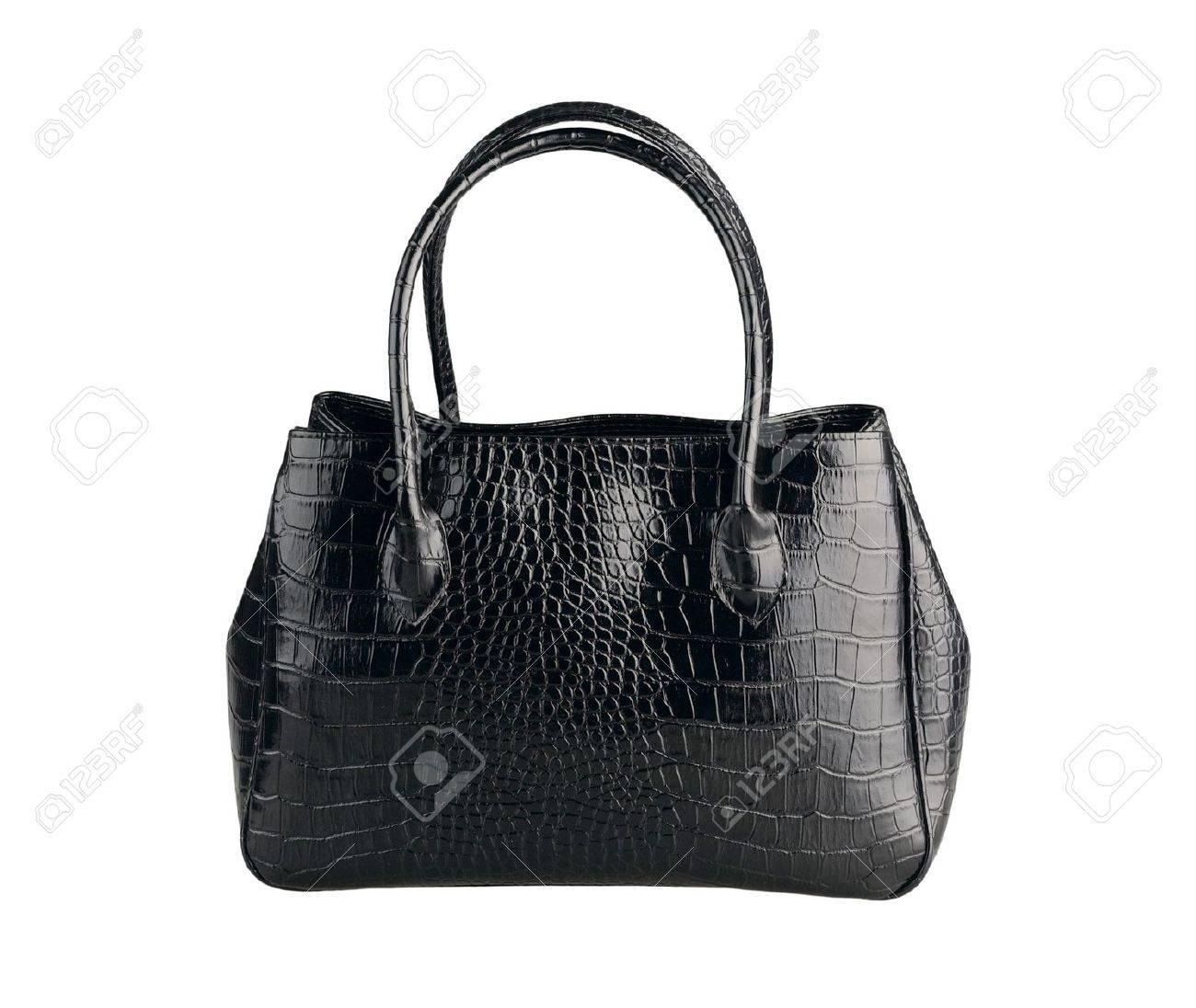fffe7de6 Beautiful black leather handbag made from crocodile leather isolates on white  Stock Photo - 15732930