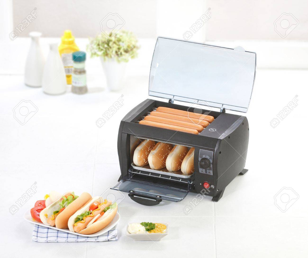 Burger And Sausages Grill Machine In The Kitchen Stock Photo ...