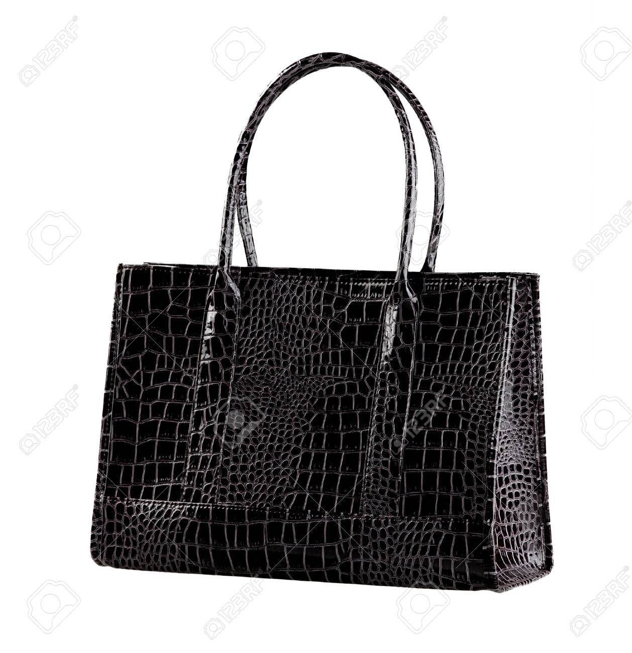 8ef6aedc Nice and beautiful lady handbag in black color made of crocodile leather  isolated Stock Photo -