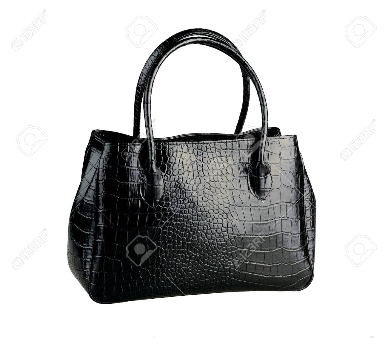 ca033d35 Beautiful black leather handbag made from crocodile leather isolated Stock  Photo - 18208493