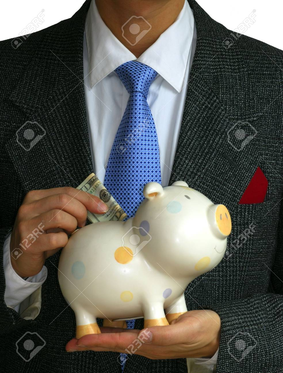 A gentleman deposits some money into the piggy bank Stock Photo - 6752099