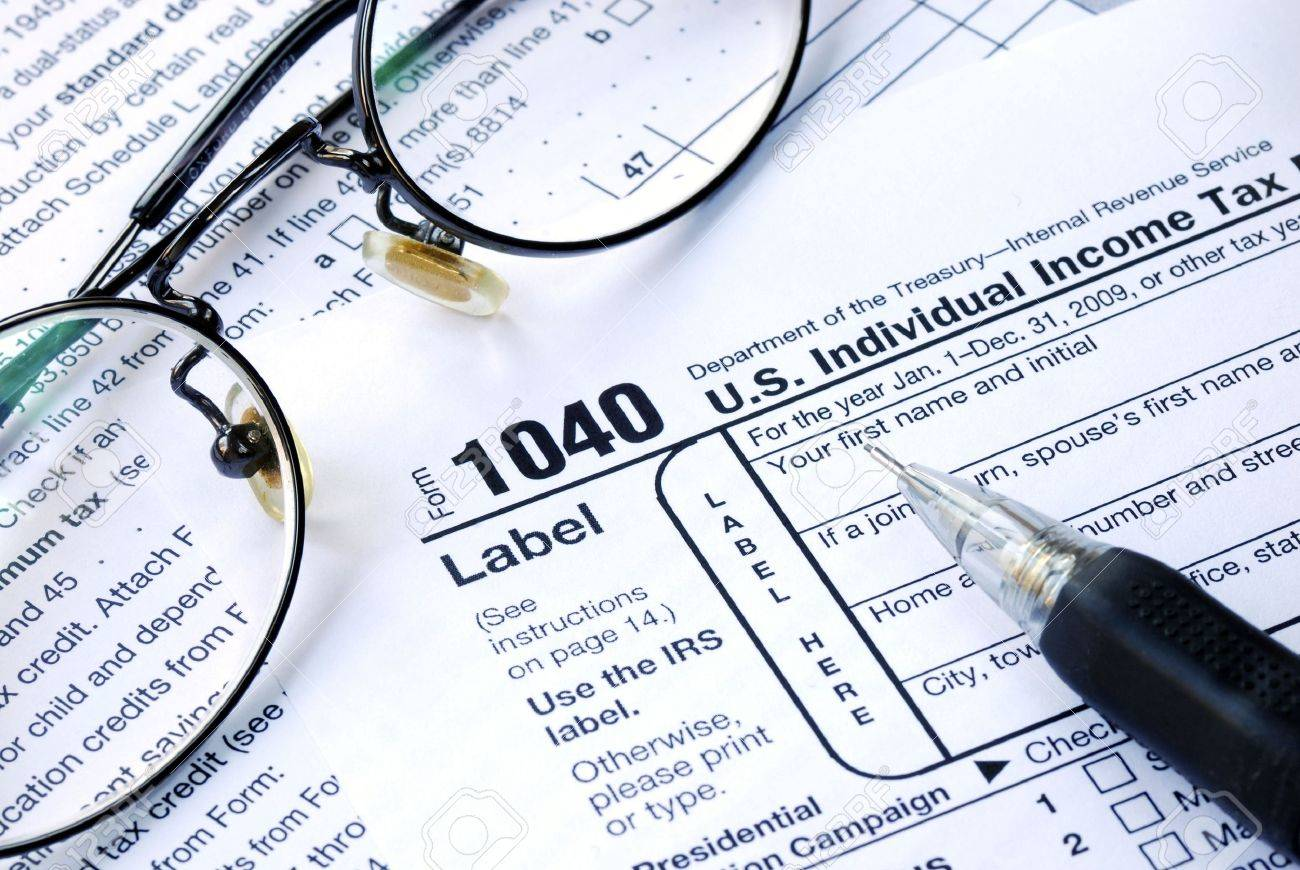 Working On The United States Income Tax 1040 Stock Photo Picture