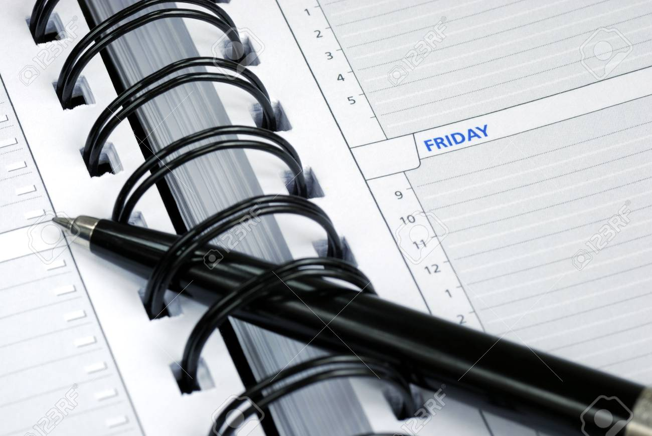 Write some notes on the day planner Stock Photo - 6752609