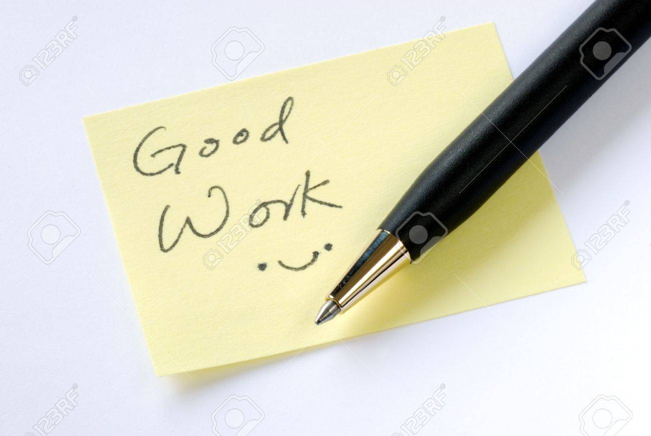 Write the words Good Work on a yellow sticky note Stock Photo - 6752130