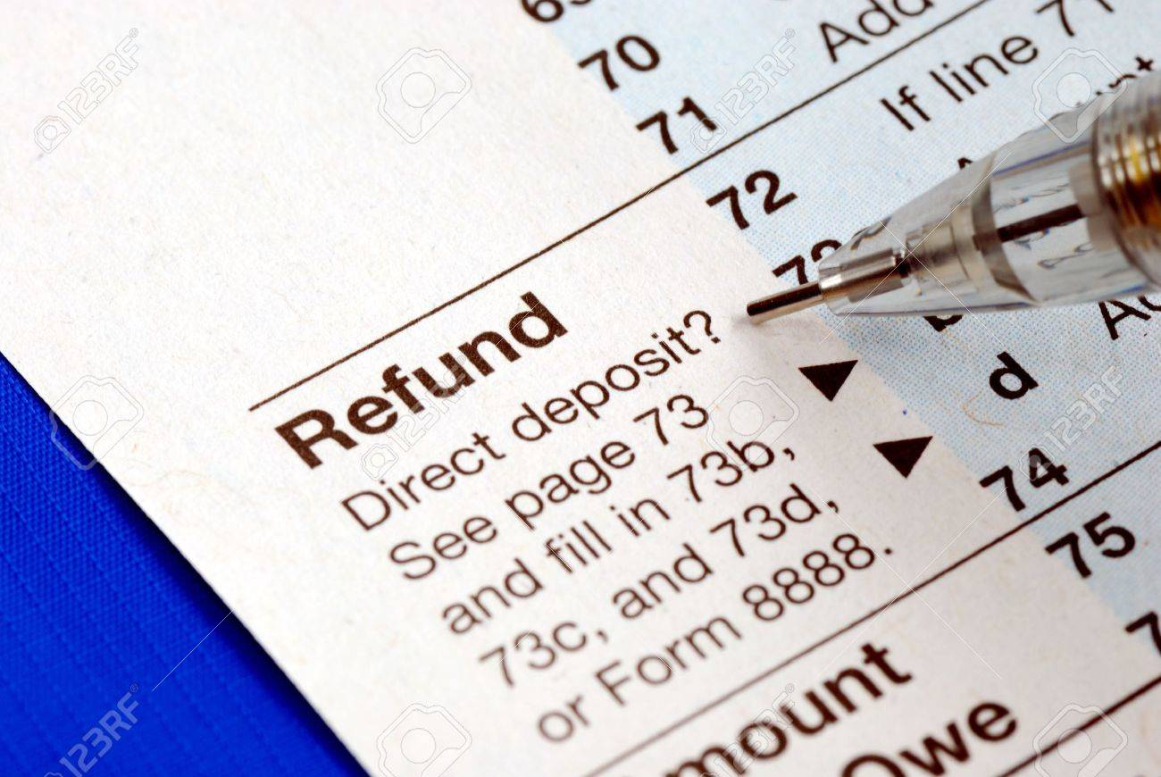 Getting refund from the income tax return isolated on blue Stock Photo - 6752379