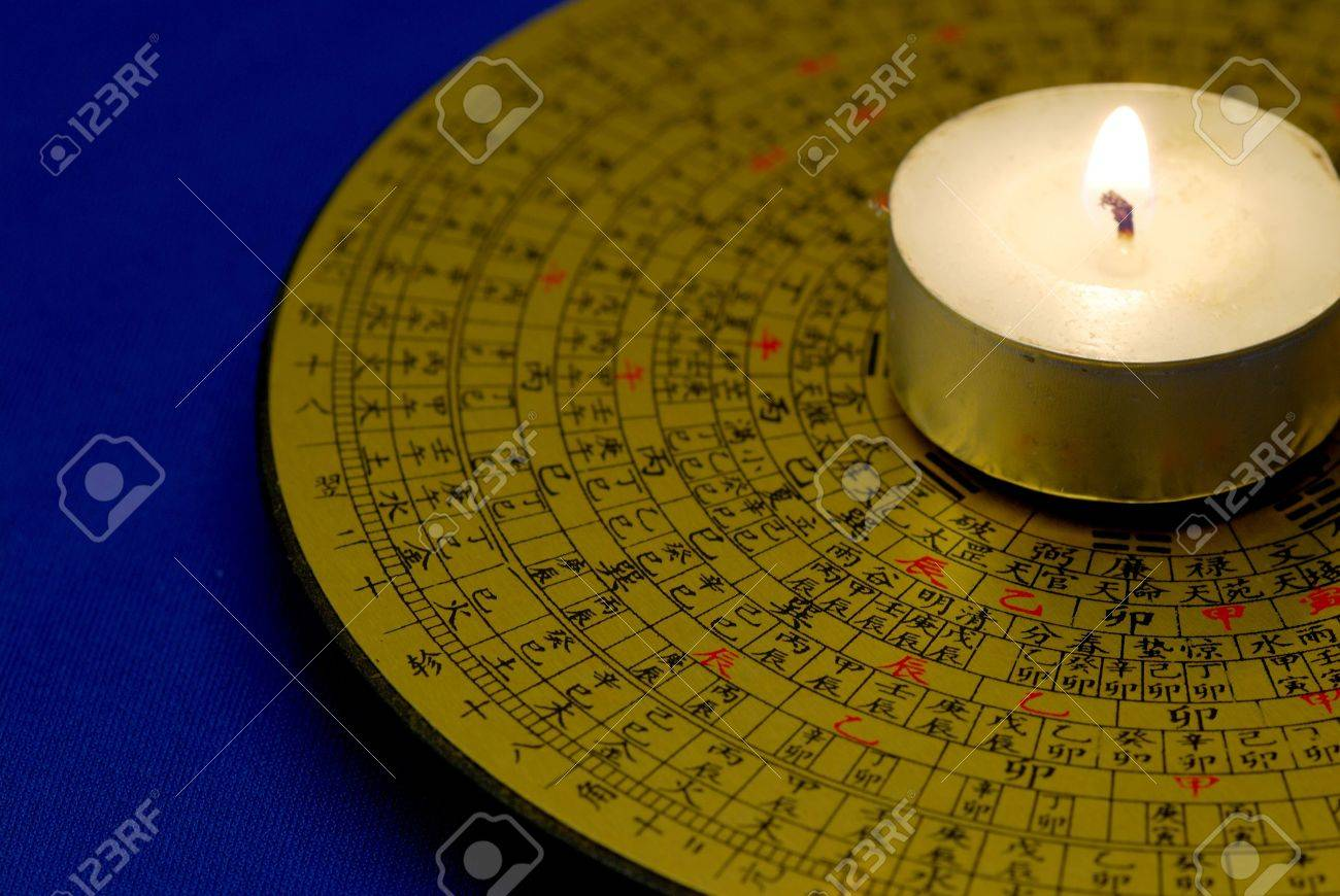 chinese feng shui compass with the candle isolated on blue stock photo 7652739 chinese feng shui compass