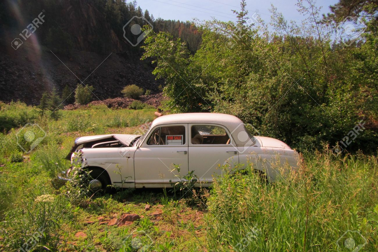 Old Abandoned Car In Ditch With A For Sale Sign In The Window Stock ...