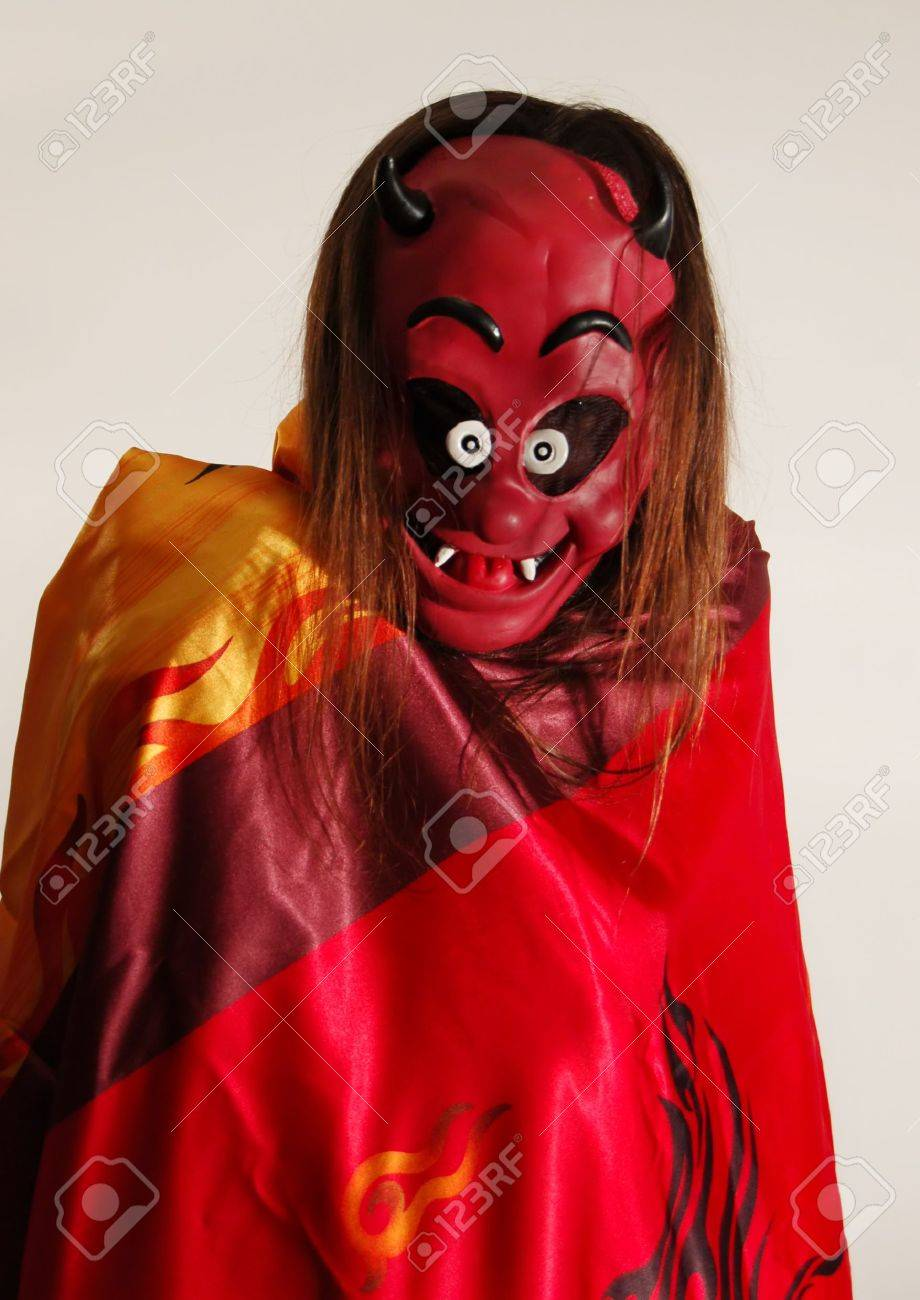 Long Hair Man In Devil Mask. Time To Halloween Party Stock Photo ...