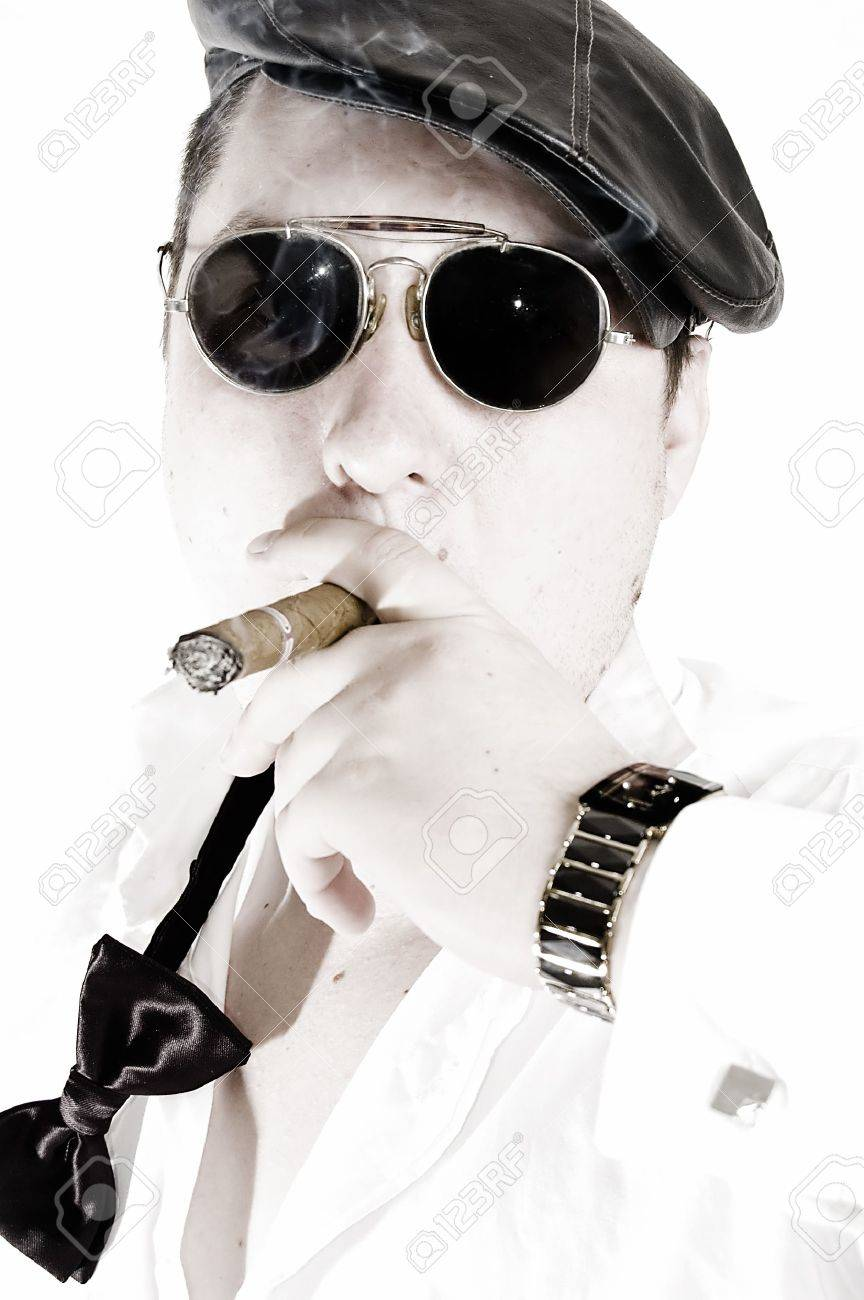 Macho man with cigar and sunglasses. High key. Stock Photo - 5834974