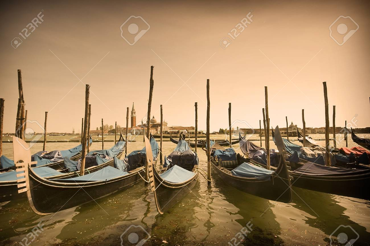 Many parked gondolas at the dusk in Venice, Italy Stock Photo - 10842690