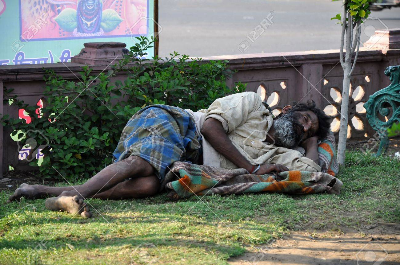 Jaipur, India – 4 November, 2009: An unidentified indian homeless man sleeps in the public park in Jaipur on November 4, 2009. Homeless people represent serious social problem through the whole India. Stock Photo - 7659330