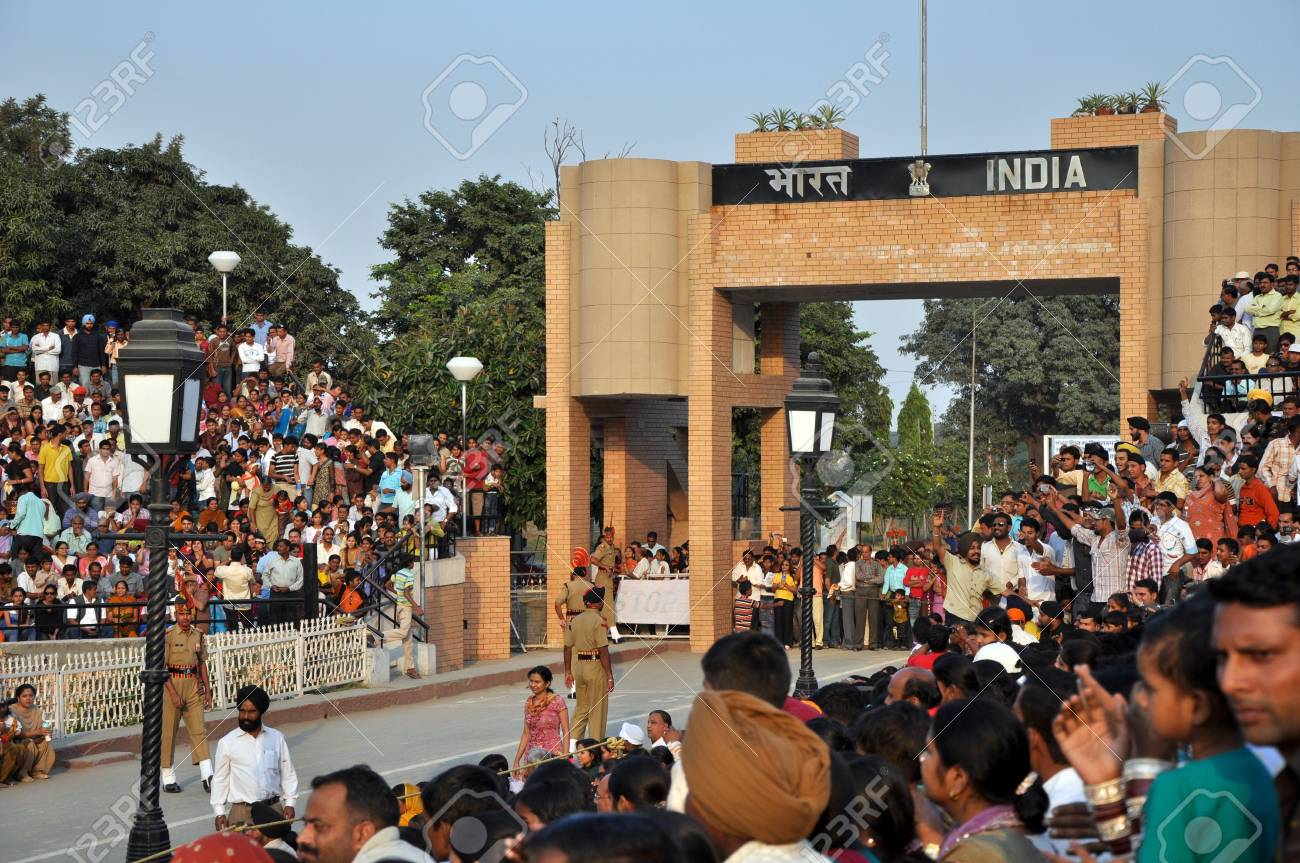 Wagah Border, Indie - 25 October, 2009: Indian visitors encourage members of indian Border security force during the ceremonial on indo-pakistan border on October 25, 2009. Ceremonial is famous for opening and closing the gate between both states Stock Photo - 7659333
