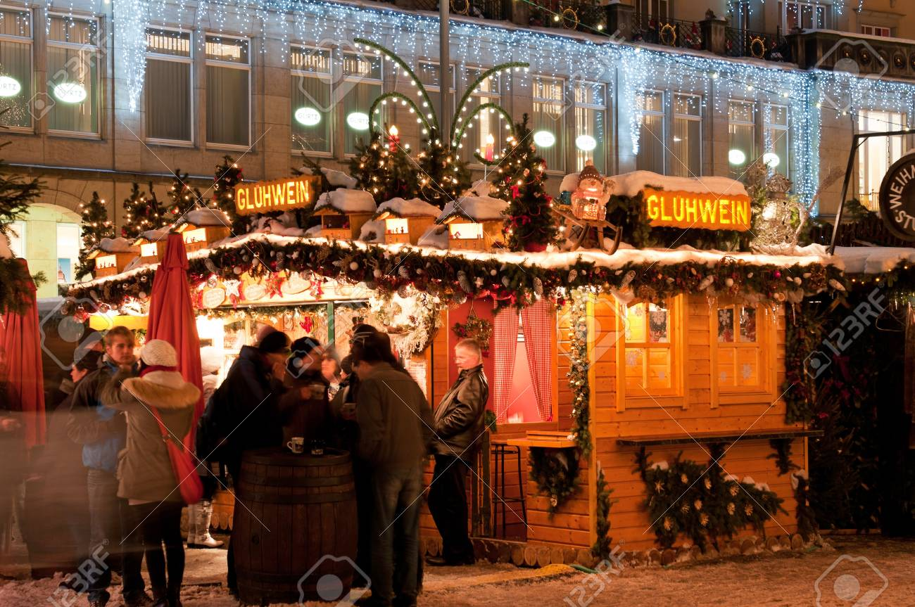 DRESDEN, GERMANY - 20 DECEMBER 2010: An unidentified group of people enjoy Christmas market in Dresden on December 20, 2010. It is Germany's oldest Christmas Market with a very long history dating back to 1434. Stock Photo - 8505426