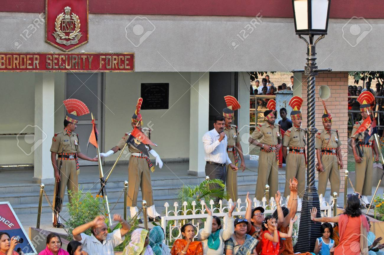 WAGAH BORDER, INDIA – 25 OCTOBER, 2009: Members of indian Border security force guard during the ceremonial on indo-pakistan border on October 25, 2009, Wagah Border, India. Ceremonial is famous for closing the gate between both states. Stock Photo - 9890205