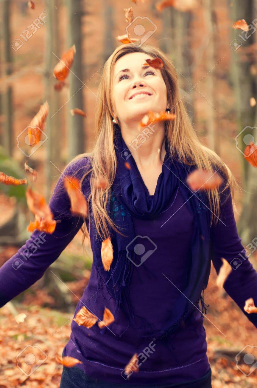 Cute caucasian model with falling leaves, vintage colors. Stock Photo - 11563288