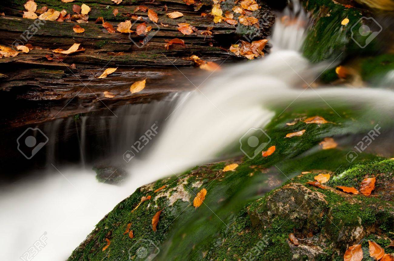 Detailed view of a beautiful waterfall during the autumn time. - 11563300