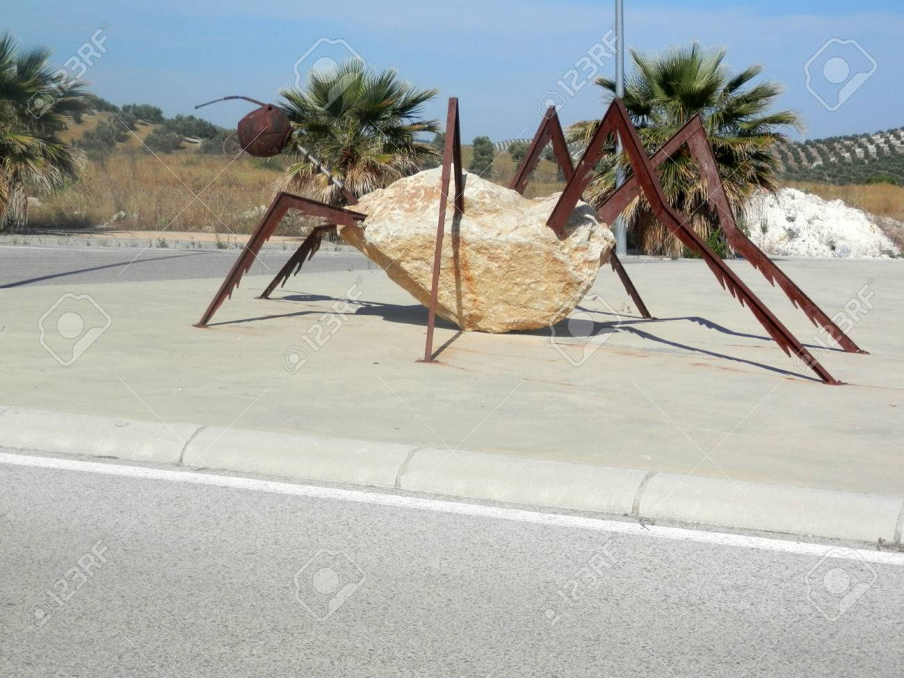 Large Steel and concrete insect on roundabout near Jaen, Andalusia - 60681872