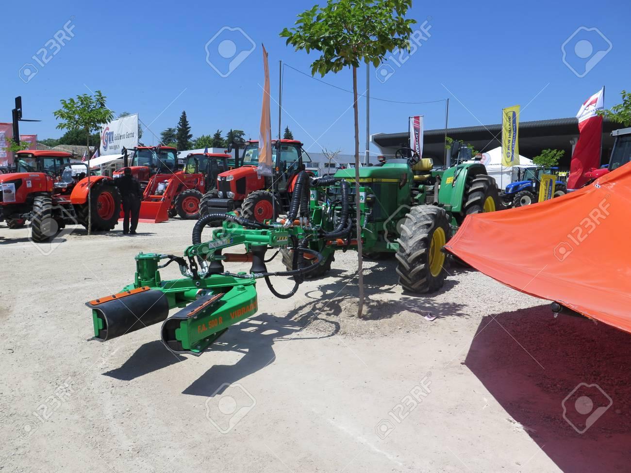 Ubeda, Spain 4 June 2016: A trunk shaker olive harvesting machine