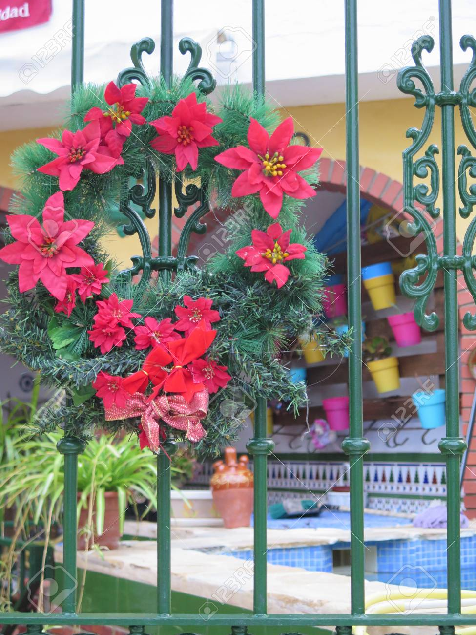 Christmas Wreath And Flowers On Garden Gate In Village Street ...