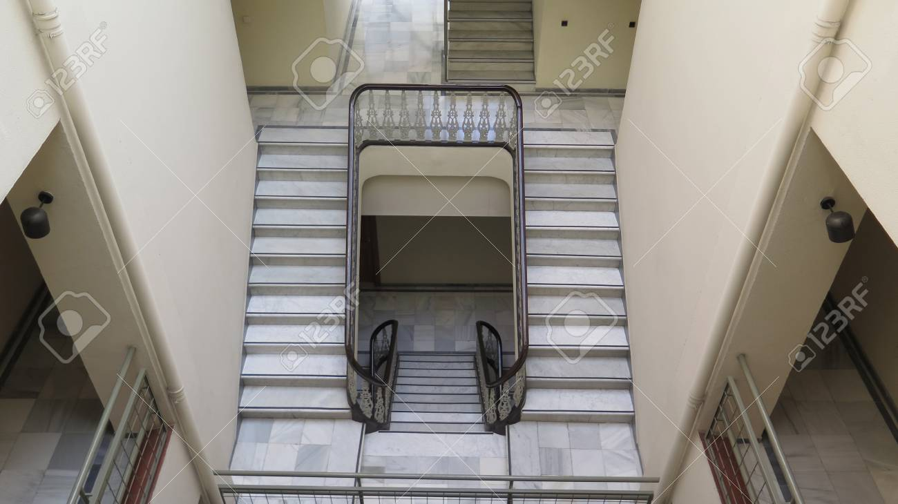 Empty stairwell and steps in old Andalusian building, Malaga - 121266833