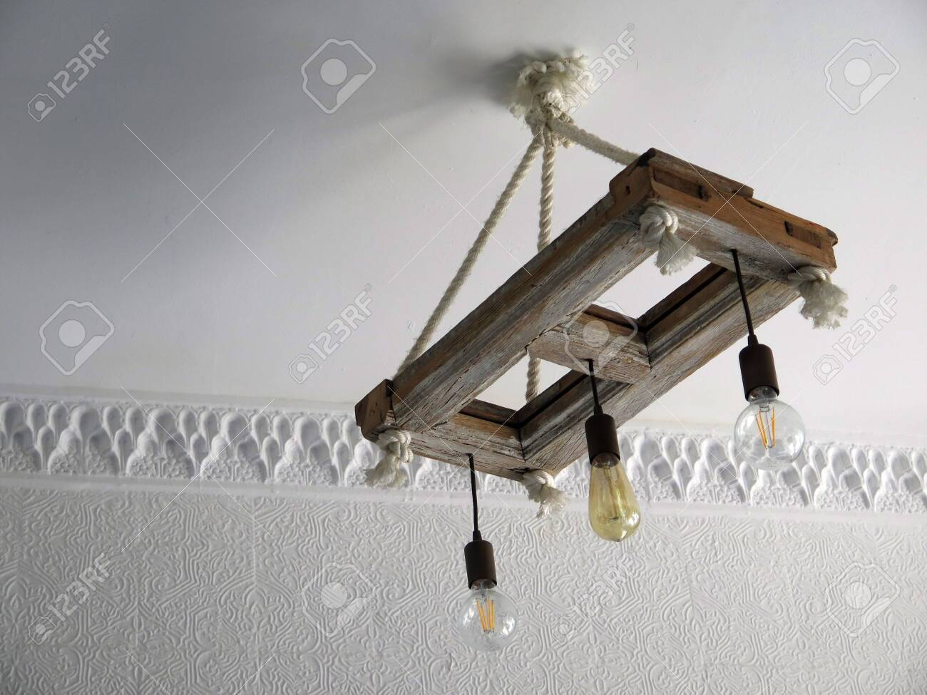 Wooden Frame And Rope Ceiling Light In Bar In Tarifa Andalusia