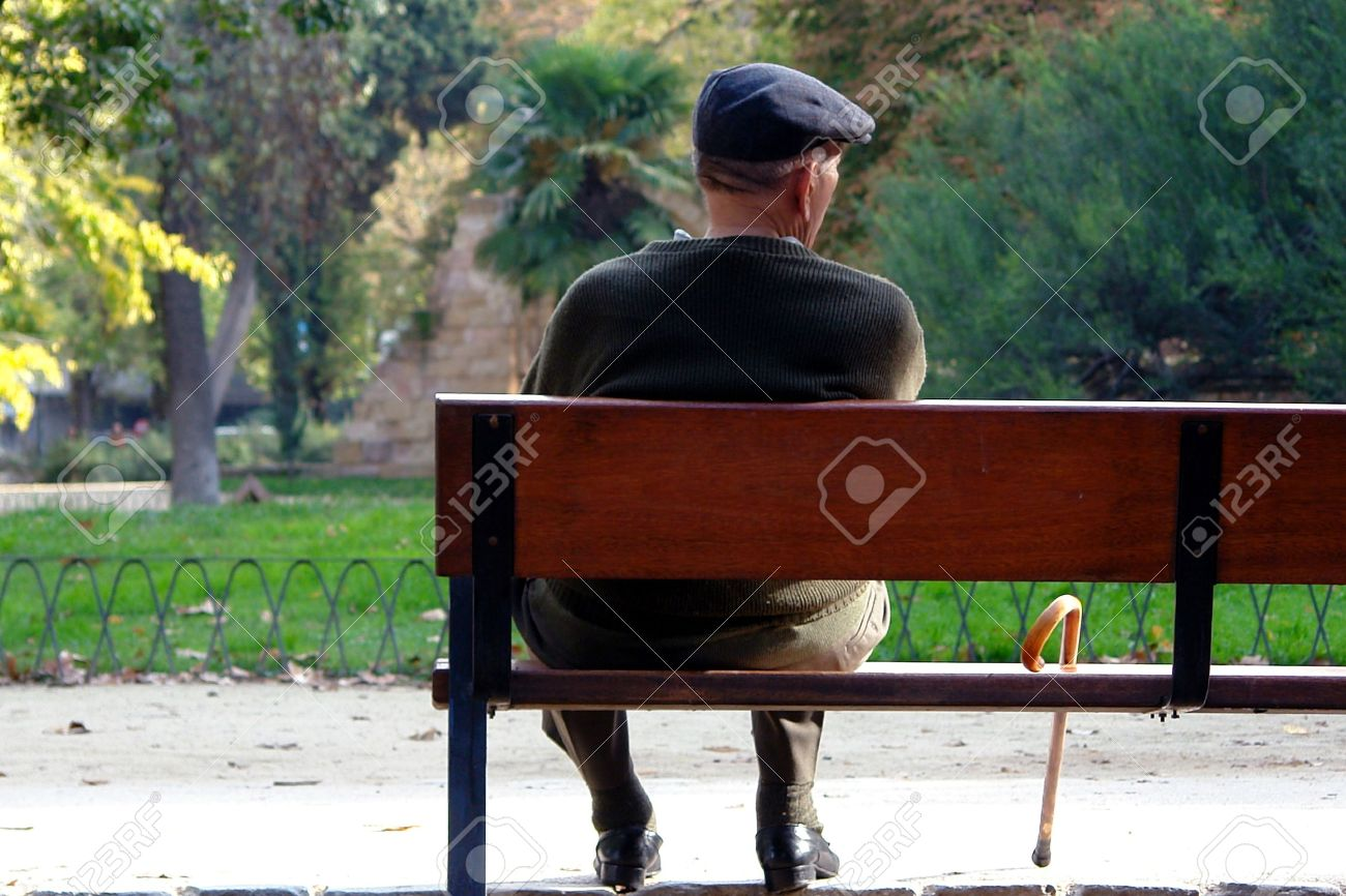 Old Man Sitting On A Park Bench Stock Photo Picture And Royalty