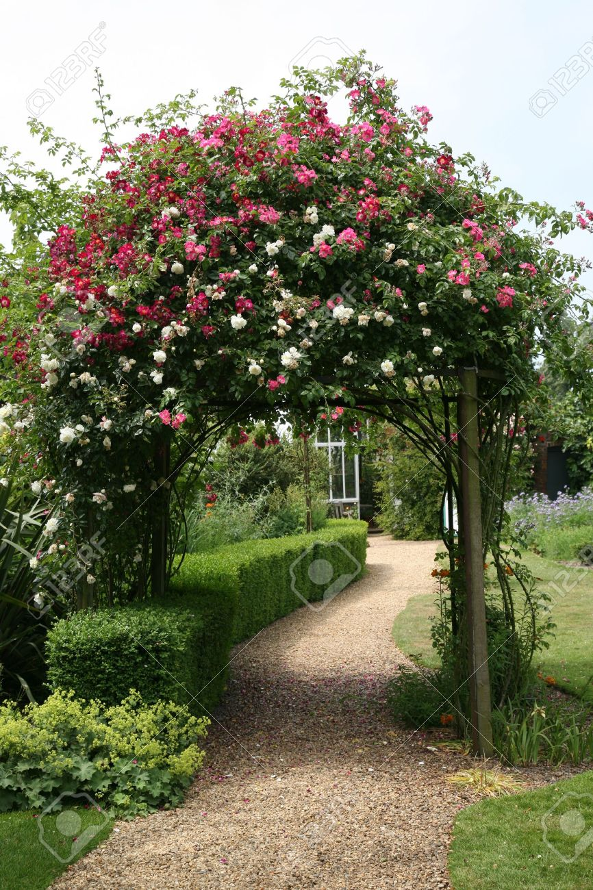 Rose Arch in English Country Garden Stock Photo - 10024893